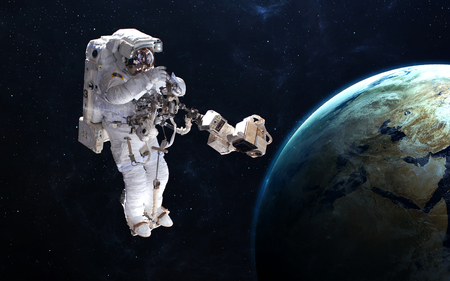 discovery: Astronaut in outer space against the backdrop of the planet.