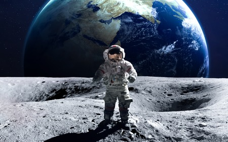 Brave astronaut at the spacewalk on the moon. Stock Photo - 50432669
