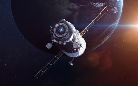 orbiting: Spacecraft Soyuz orbiting the earth.