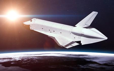 orbiting: Space Shuttle Orbiting Earth.