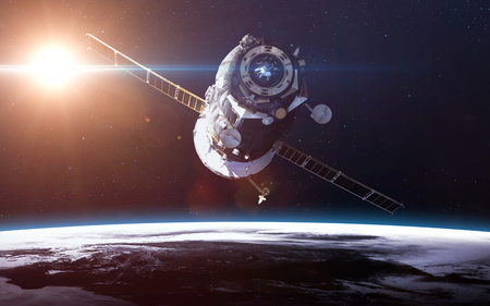 Spacecraft Soyuz orbiting the earth.