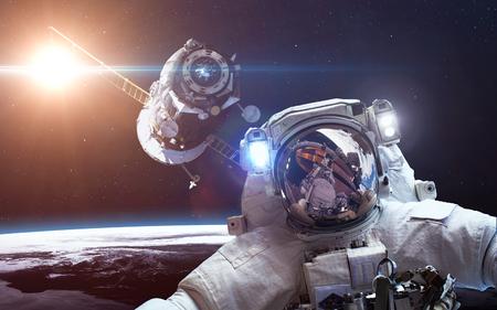 orbiting: Spacecraft Soyuz orbiting the earth