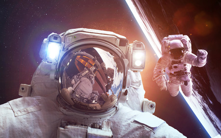 telecommunication: Astronaut in space over the planet Earth Stock Photo