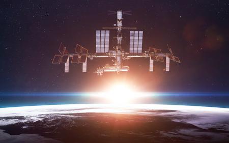 International Space Station over de planeet Aarde Stockfoto