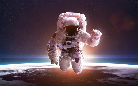 earth space: Astronaut in space over the planet Earth Stock Photo