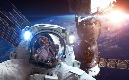 orbital spacecraft: International Space Station with astronaut over the planet Earth. Stock Photo