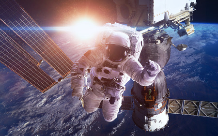 International Space Station with astronauts over the planet Earth. Foto de archivo