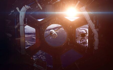 orbital station: A round window on a space station with a view of Earth below. This image elements furnished by NASA