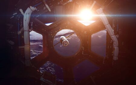 sf: A round window on a space station with a view of Earth below. This image elements furnished by NASA
