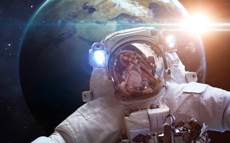 Astronaut in space over the planet Earth. Elements of this image furnished by NASA Stock Photo