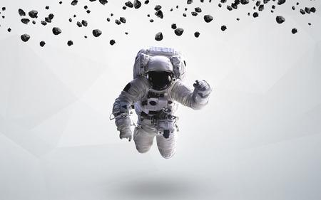 Astronaut in outer space modern art. Standard-Bild
