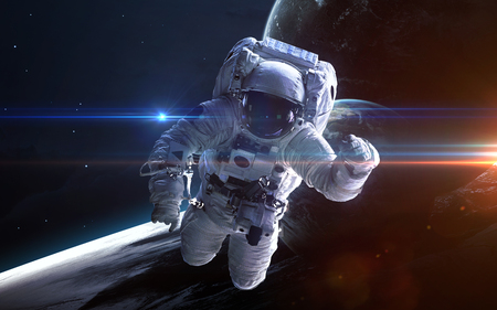 宇宙空間で宇宙飛行士。宇宙遊泳。NASA から提供されたこのイメージの要素 写真素材