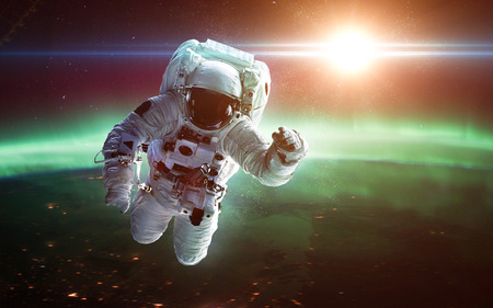 dust cloud: Astronaut in outer space. Spacewalk.