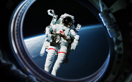 Earth planet and astronaut in space ship window porthole. Stock Photo