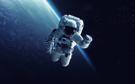 Astronaut at spacewalk. Cosmic art, science fiction wallpaper. Beauty of deep space. Billions of galaxies in the universe.