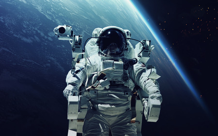 billions: Astronaut at spacewalk. Cosmic art, science fiction wallpaper. Beauty of deep space. Billions of galaxies in the universe.