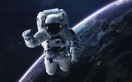 Astronaut. Abstract space wallpaper. Universe filled with stars, nebulas, galaxies and planets. Elements of this image furnished by NASA Stock Photo