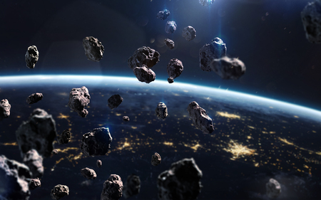 Asteroids near Earth. Meteorites orbiting planet. Deep space image, science fiction fantasy in high resolution ideal for wallpaper and print. Elements of this image furnished by NASA Stock Photo