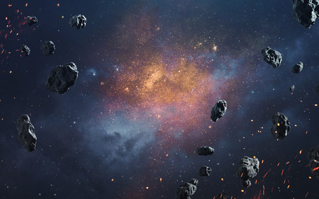 Abstract cosmic background with asteroids and glowing stars. Deep space image, science fiction fantasy in high resolution ideal for wallpaper and print. Elements of this image furnished by NASA Stock Photo