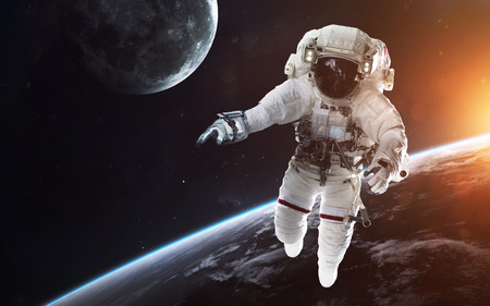 Brave astronaut at the spacewalk. People in space.