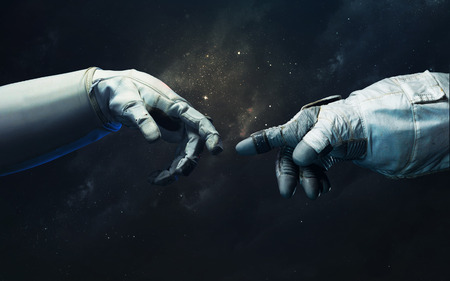 Hand of astronaut and robot. Science fiction wallpaper.