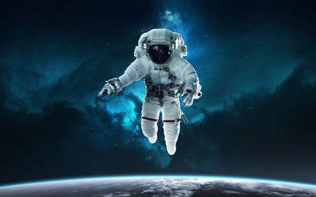 Astronaut and Earth planet. Science fiction wallpaper.