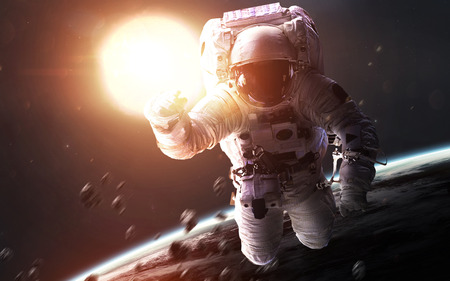 Astronaut in front of glowing Sun. Space science fiction visualization.