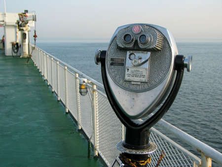 Telescope looking out over the ocean on a ferry boat Stock Photo