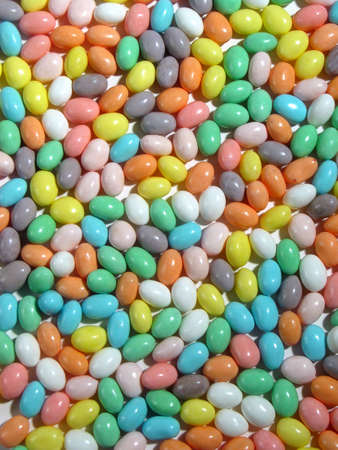 Different colored pastel Jellybeans fill an entire image from edge to edge Stock Photo