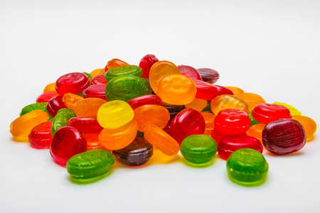 Colorful hard candies on a white background Imagens