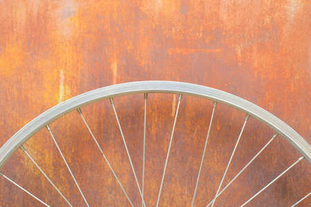 rust background: bicycle whell with rust background