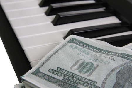 fake money: Piano keyboard with a fake money close up