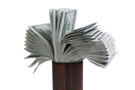 fake money: Bunch of fake money in a vase isolated over white