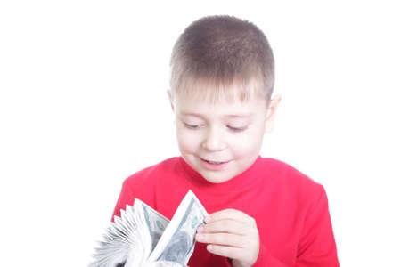 fake money: Boy in red jacket calculating fake money isolated