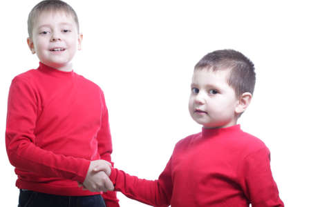 Two boys shaking hands isolated over white