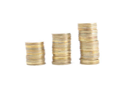 Row of three coin columns isolated over white Stock Photo