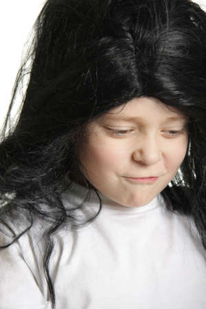 skeptic: Boy with black dishevelled hairs with skeptic look isolated  Stock Photo