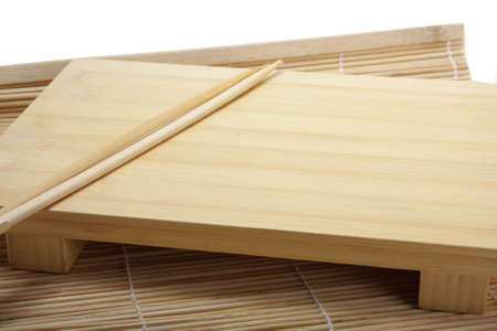 susi: Susi wooden emty set and chopsticks on a straw mat