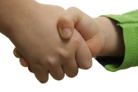 settled: Child hand shake isolated over white background