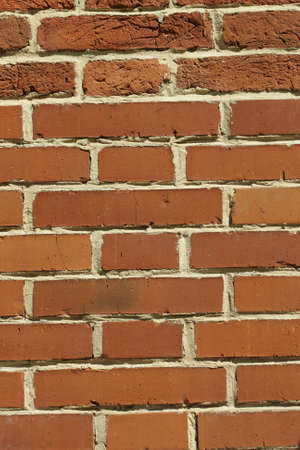 indentation: Red brick wall part with smooth and rough sections
