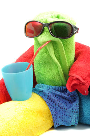 Toy towel man drinking from blue cup isolated