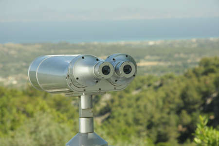 intended: Fixed binoculars with metallic body intended for sightseeing Stock Photo