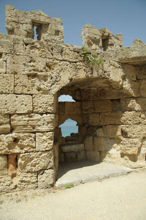embrasure: Loophole on a wall of old castle in Rhodes