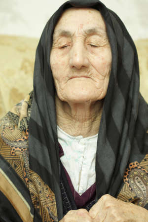Very old woman closed eyes in sorrow Stock Photo - 3298362