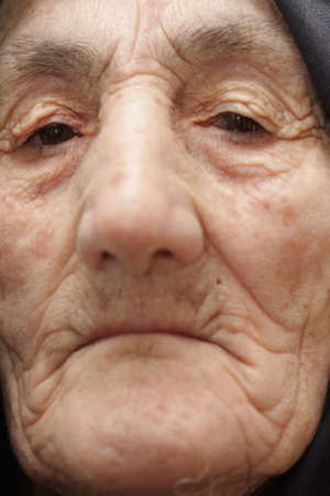 Old woman looking straight to camera closeup Stock Photo - 3342785