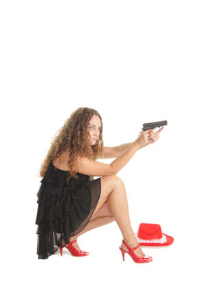Pretty curled girl in black dress with gun isolated Stock Photo - 3425755