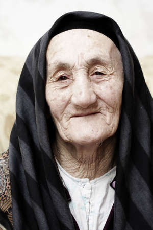 Very old grandmother looking to camera with kind Stock Photo - 3463331