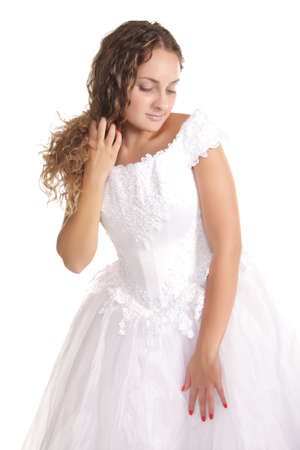 modesty: Pretty bride in a white dress with modesty expression isolated