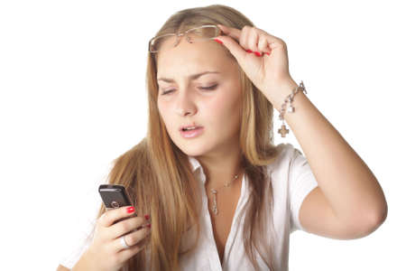 Pretty fairhaired girl trying to read message on phone isolated photo