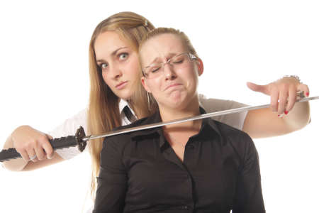 Two girls demonstrating difficuilt situation isolated over white Stock Photo